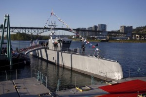 "The autonomous ship ""Sea Hunter"", developed by DARPA, is shown docked in Portland, Oregon before its christening ceremony"